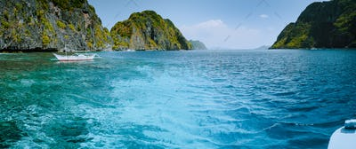 Palawan Bacuit archipelago. Panoramic shot of ocean strait between Mantinloc and Tapiutan islands on
