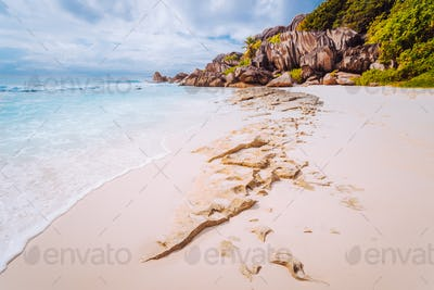 Amazing Granite rocks, white sand and blue clear ocean at Grand Anse, La Digue island, Seychelles