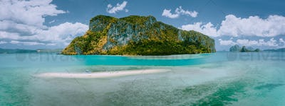 Palawan, Philippines. Aerial drone panoramic view of sandbar with lonely tourist boat in turquoise