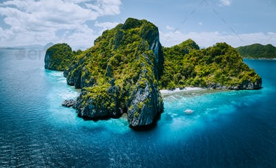 Aerial panorama of tropical paradise Entalula Island and clear blue water El Nido, Palawan
