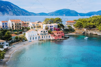 Cute blue sea bay in front of Assos village. Beautiful view to vivid colorful houses near blue