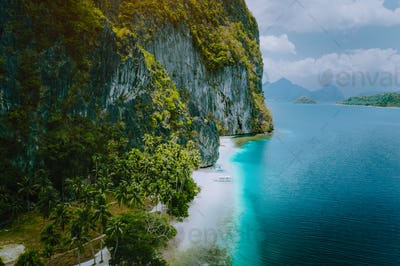 El Nido, Palawan, Philippines. Aerial drone view of tourist boats arriving tropical Ipil beach on