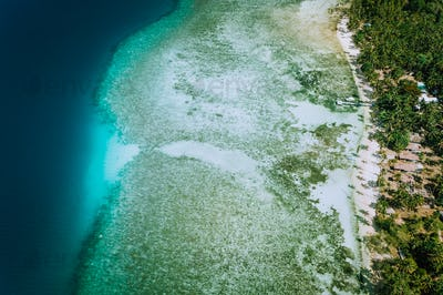 Aerial drone view of coral reef and shallow transparent lagoon water El Nido. Top down view. Bacuit