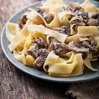 Pasta tagliatelle  with  mushrooms