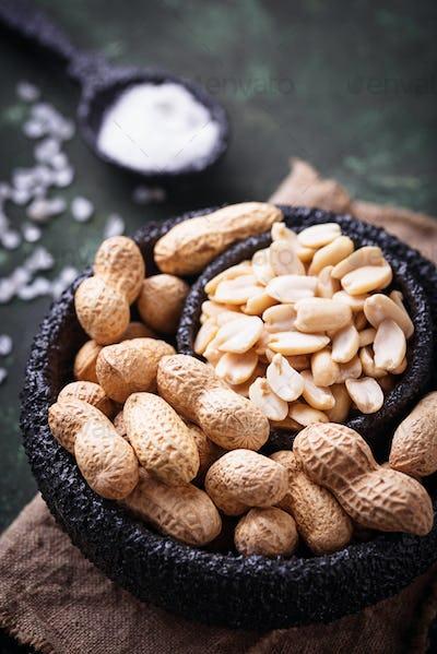 Raw peeled peanuts on bowl