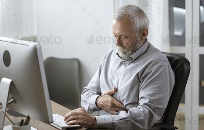Senior man having a bad stomach pain