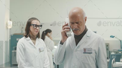 Retro style scientist receiving an important phone call