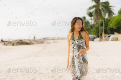 Portrait beautiful asian women happy smile relax on the tropical