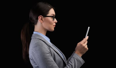 Businesswoman Using Smartphone Face Recognition System On Black Background