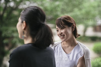 two young japanese woman talking