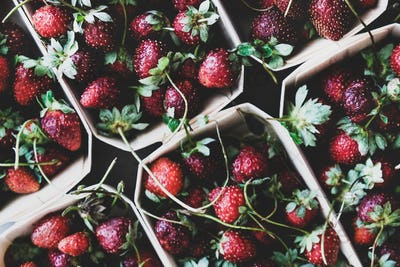 Food texture, background, wallpaper with fresh garden strawberries in boxes
