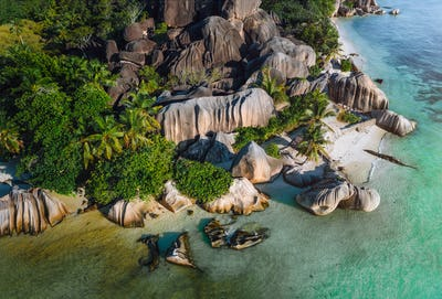 Aerial photo of Seychelles tropical beach Anse Source d'Argent in evening light at La Digue