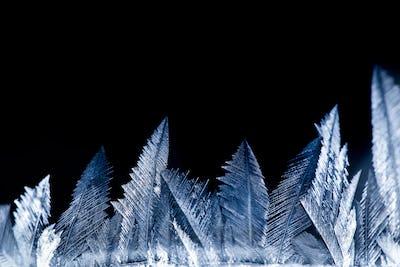 Freezing snow pattern close-up, winter holidays background
