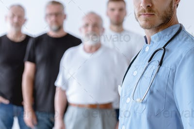 Psychiatrist and group of men