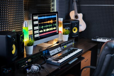 Electrical equipment for recording and computer monitor on workplace of deejay