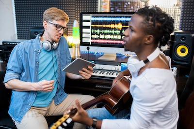 Young singer or musician of African ethnicity and his colleague recording song