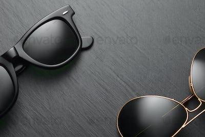 Classic sunglasses on black slate background