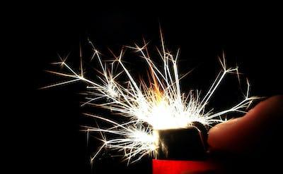 Long Sparks Shoot From a Cigarette Lighter