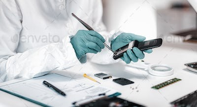 Forensics. Police Expert Examining Confiscated Mobile phone