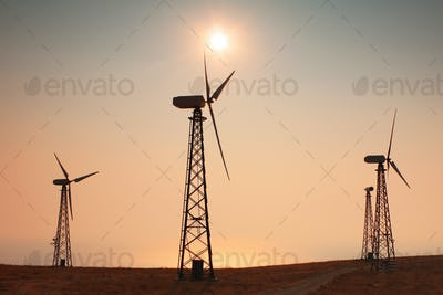 Wind generator on the background of the sunset sky