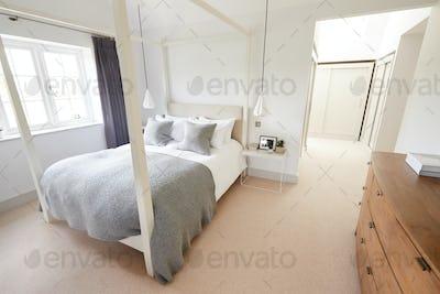 Empty Interior Of Stylish Master Bedroom With Storage