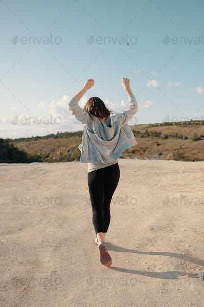 Young girl walks in a career sunny summer evening