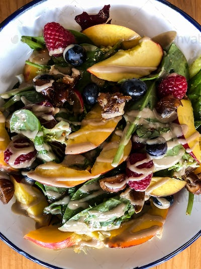 Top view of green salad with fruits