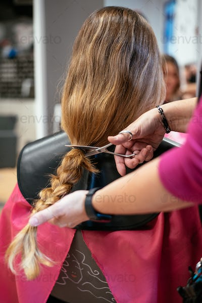 Woman donating hair for cancer