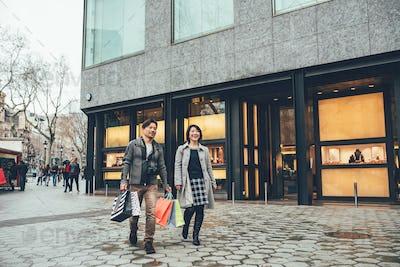 Asian couple shopping in barcelona
