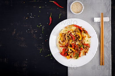 Noodles with shimeji mushrooms and paprika. Oriental meal. Japanese Shimeji mushroom stir fry.