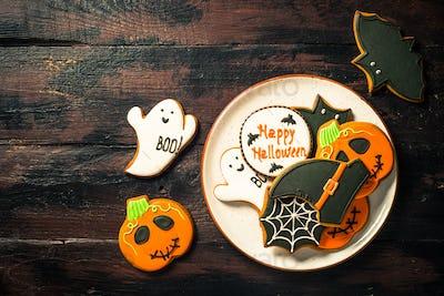 Halloween Gingerbread Cookies - pumpkin, ghosts, bat, on woden table