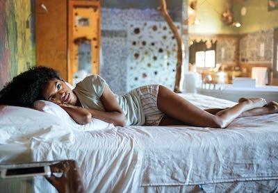 Beautiful black woman in bed
