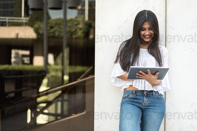 close up portrait student young woman with tablet smiling