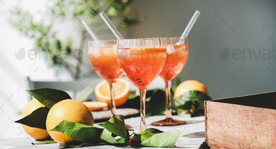 Aperol Spritz cocktail in glasses with fresh oranges, close-up