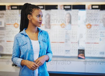 Young confident woman opening own store