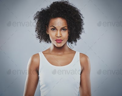Centered front view of pretty grinning woman