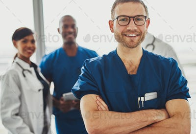 Young doctor in front of team