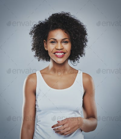 Portrait of smiling happy woman, black woman on grey background