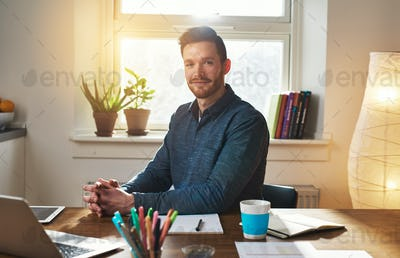 Successful businessman sitting thinking