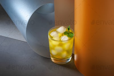 Ice cold drink on creative color background.
