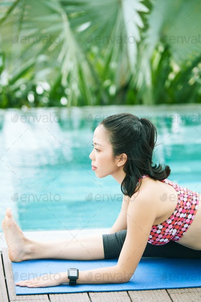 Woman stretching near the poolside
