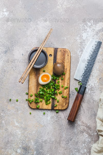 Marinated egg on wooden board, copy space