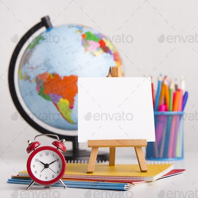 Close up of easel and office stationery on white background