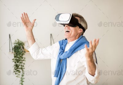 Augmented reality. Mature man with virtual headset