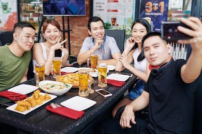 Selfie portrait of friends in cafe