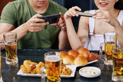 People photographing food