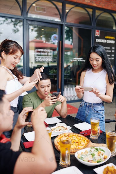 People making photo of meal