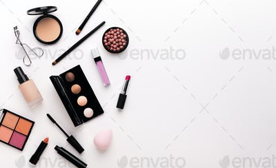 Luxury makeup products creating frame on white
