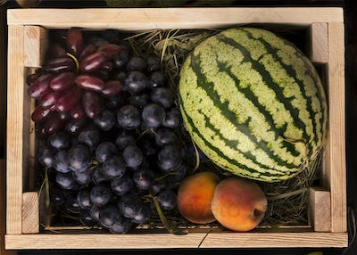 Eco fruits rich on vitamins in wooden box