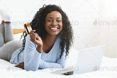 Cheerful woman making online purchases from home